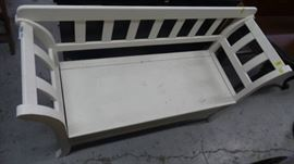 Bench with storage space filled with a variety of ...