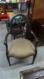Chair with cushion.