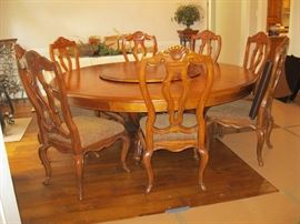 Huge round Oak table and 9 chairs and pads for table as well