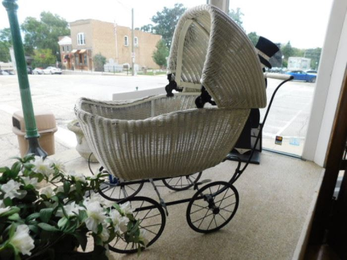 Antique wicker baby stroller