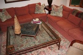 Pair of Sofas, Large Metal & Class Square Coffee Table, Accent Pillows, and Rug with Decorative Items