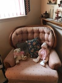 Comfy chair holding a doll!