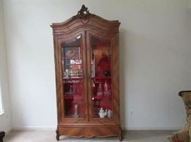 1940s French Walnut Heavily Carved Armoire Beveled Glass Doors