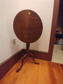 SOLID MAHOGANY Tilt top table. $50.