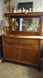 Antique  buffet with mirror and claw feet. The family was told it is Chestnut.