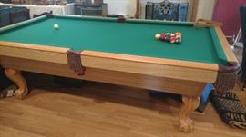 Steepleton pool table with ping pong table top, balls, cue sticks, cue rack-only used once.  The felt is in excellent condition.