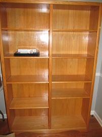 The taller of the 2 oak bookshelves