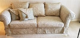 Beautiful couch that has rarely been sat on!!