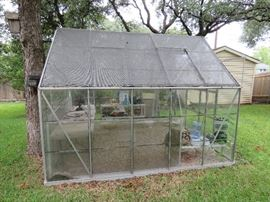 8' x10' Glass Panel Greenhouse. 4' sliding doors. There are two cracked panels. Pre Sale available $650