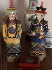 Chinese emperor porcelain statues.