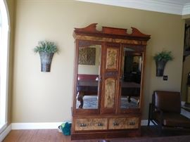 antique  armoire  with  beveled  glass  panels