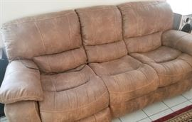 Like new 3 piece Livingroom set including power recliner sofa, manual 2 seat rocker recliner sofa, oversize rocker