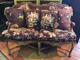 Louis XV style settee with cane back.