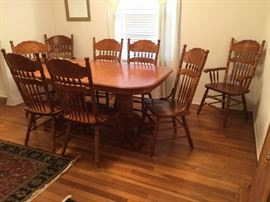 Golden oak dining table with 2 leaves. Comes with 12 count em 12 chairs. 2 arm and 10 side chairs.Pressed back golden oak.  795.00 What a deal !!! Call 210-222-0265 if you want to see this set!!