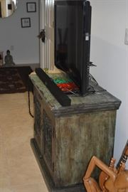 """This real wood cabinet is a versatile piece that will last a lifetime! Use as an entertainment center, cabinet for kitchen, or storage for clothes or any storage you'd like. Details: Distressed Green Wood in Color; Condition: Excellent; Size: 36"""" x 20"""""""