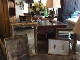 Antique leather top desk in excellent condition, assorted mirrors, oil painting and many other framed pieces