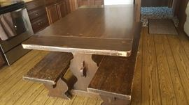Heavy dining table with benches