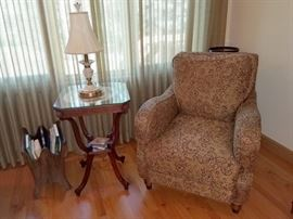 Upholstered armchair. Antique accent table