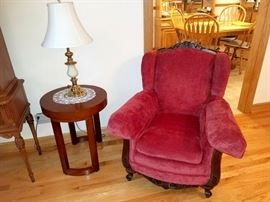 Crushed velvet armchair with carved wood. Modern accent table