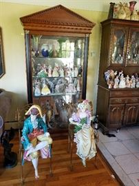 art glass ,lladros, two large porcelain figures on metal chair