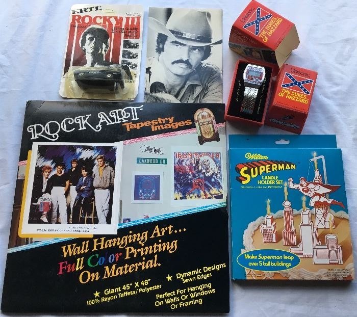 Never used / Deadstock items in quantity including Burt Reynolds Cards, Superman items, Dukes of Hazard Watches, Rocky Cars