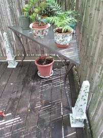 Potted plants, obelisks, and vintage triangle table