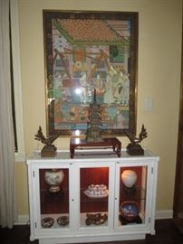 Indian silk painting, bronze burmese chinthe, cast iron pagoda, lighted cabinet  with stuff in it