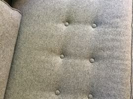 Close up of button pattern on sofa cushion