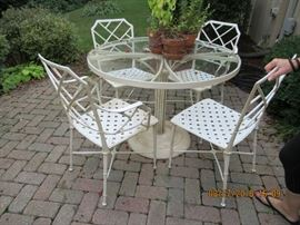 Patio set metal Asian flair chairs with glass topped table