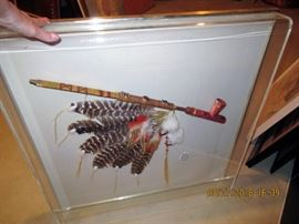 "Peace pipe and headdress in an acrylic frame,  "" end of an era, lost cities replica"""