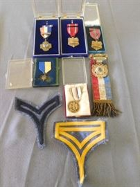 Various medals and patches