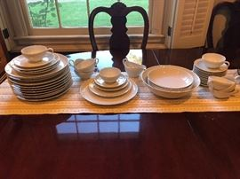 Set of white dishware - and lovely dining table and eight chairs