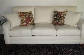 Off white fabric sofa.