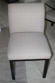 One of seven dining chairs.