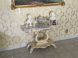 Harp table - solid wood with marble top.  Also the statuary and the Capodimonte centerpiece -- rare (non-floral one)