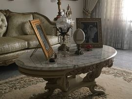 Oval, solid marble top coffee table, crystal and bronze candy dish...
