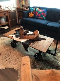 Railroad depot style luggage cart coffee table.  (Please read the terms and conditions regarding our sales) Set up and Photo by BC