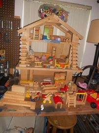 Wood Doll House with wood furnishings by Ryan;s Toys