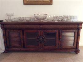 Cindy Crawford Key West Living Room Console shown with a collection of crystal pieces...