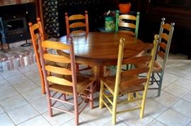 Antique round oak pedestal table and six vintage ladder back chairs,