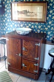 Antique oak ice box, granite ware and limited edition Western print.