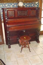 Ornate antique 1890's organ and organ stool.