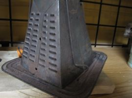 Old wood stove top or camping toaster