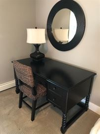 Office desk, round mirror, lamp and seagrass desk chair