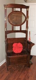 GORGEOUS ANTIQUE HALL TREE WITH UNDER SEAT STORAGE AND ORIGINAL UMBRELLA DRIP PAN. BEVELED MIRROR IS BEAUTIFUL!