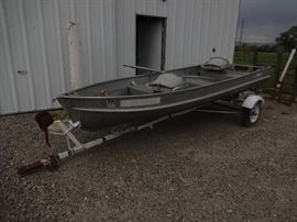 12 foot AlumaCraft boat and trailer with oars.