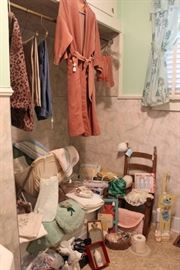 Vintage rolling laundry cart, bathtub is full of vintage bed linens, nice vintage curtains on the window