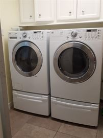 LG front loading washer and dryer with pedestals