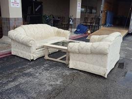 Cream sofa, loveseat and coffee table
