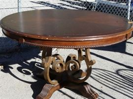 This table is lovely with its metal base and dark stain.